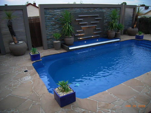 Modern Pool With Water Features