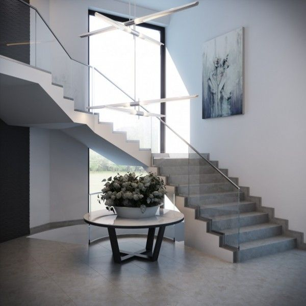 Sweeping Staircase with a Modern Glass Rail