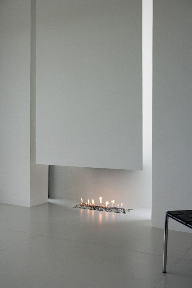Minimal hearth inside the B25 House by PK Arkitektar