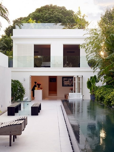 How to create seamless indoor outdoor living spaces destination living for White house swimming pool indoor