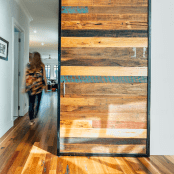 A woman walks down the wooden hallway of her new custom built home by Destination Living