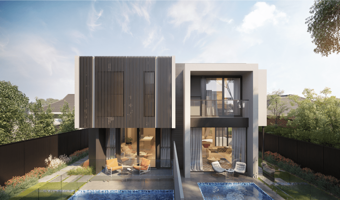 Two modern custom built homes sitting side by side, conjoined in the middle with grey colour tones. A fence runs through the centre of the build to allow for privacy.