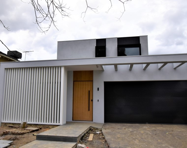 In construction Façade of Luxury architect design home in Balwyn North by destination living